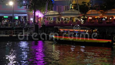 Tourist boat mooring to a pier Riverside area stock footage