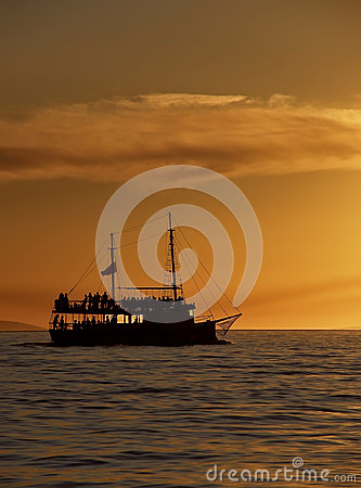 Tourist boat  in sunset