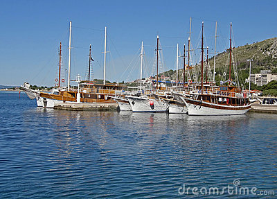 Tourist boats in harbor Omis