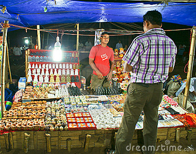 Tourist buying items from a hawker in Puri beach Editorial Photography