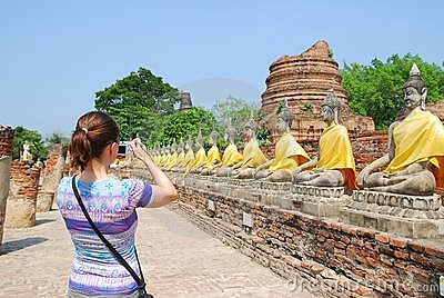 Tourist with camera in front