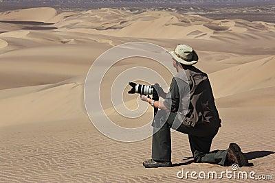 Tourist with camera - Namib Desert - Namibia