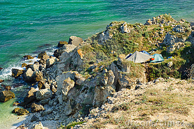 Tourist camp at rocky coast