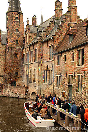 Tourist canal boat in Bruges (Belgium) Editorial Stock Photo