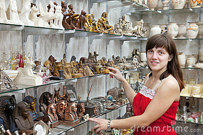 Tourist  chooses souvenir  in egyptian shop