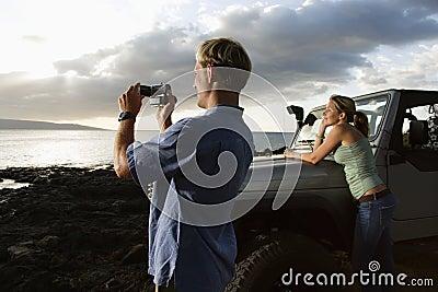Tourist Couple Enjoying a Beach Sunset