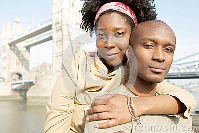 Tourist couple in London with map.