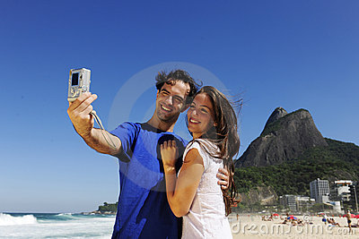 Tourist couple in Rio de Janeiro taking a photo