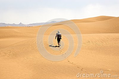 Tourist Among The Desert Dunes Royalty Free Stock Images - Image: 28453019