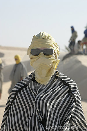 Tourist dressed like bedouin with sunglasses