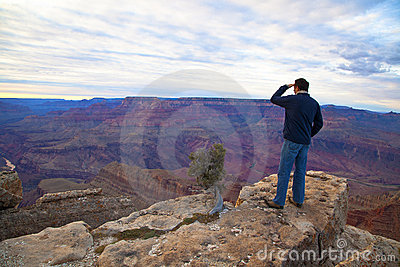 Tourist on the  edge of  Grand Canyon