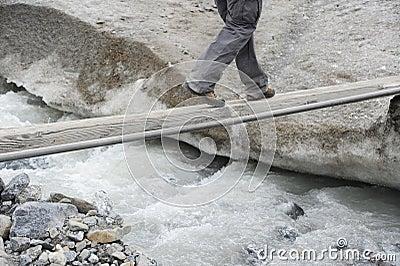 A tourist on a footbridge