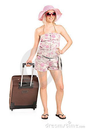Tourist girl carrying a luggage