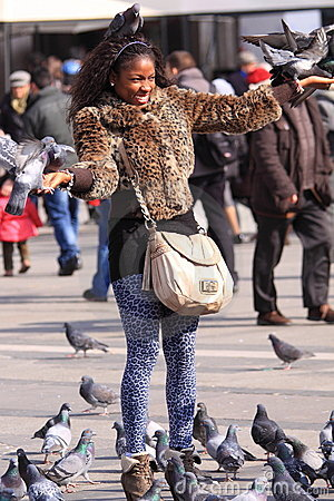 Tourist girl with pigeons Editorial Photo