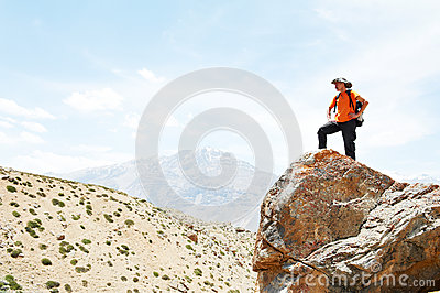 Tourist hiker hands up on mountain top