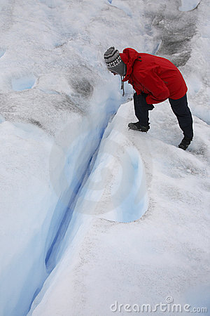 Tourist looking into a crevasse - Argentina