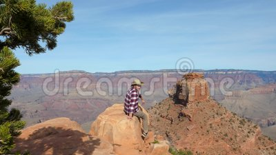 f13fddb60c0 Caucasian Man Sitting On The Rock Edge And Looking Amazing View Of Grand  Canyon Stock Footage - Video of america