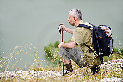 Tourist man hiking pole