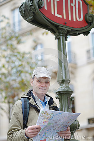 Tourist with a map in Paris, France