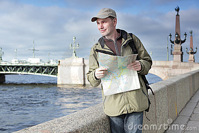 Tourist with a map in St. Petersburg, Russia