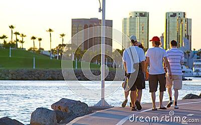Tourist men walking at the beach