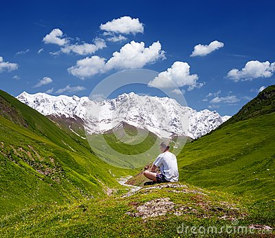 Tourist in the mountains of the Caucasus