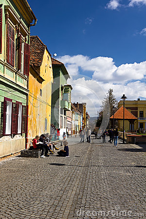 Tourist in the old town center of Sibiu Editorial Stock Image