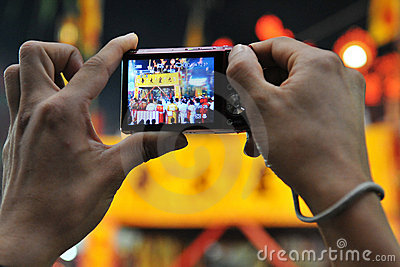Tourist Photographs a Taoist Ceremony Editorial Stock Photo