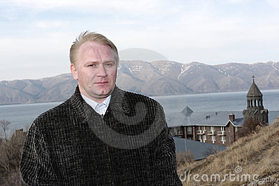 Tourist poses on monastery background