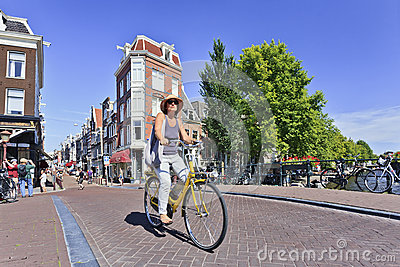 Tourist on a rental bike enjoys Amsterdam Editorial Photography