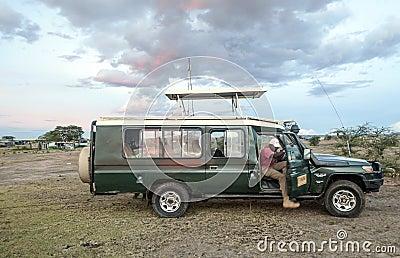 Tourist in safari car