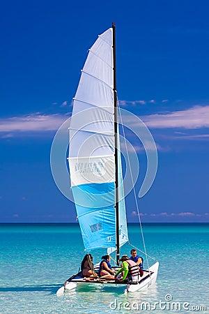 Tourist sailing in a catamaran on a cuban beach Editorial Photography