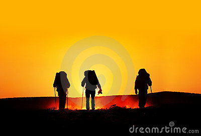 Tourist silhouettes at sunset