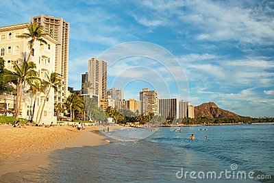 Tourist sunbathing and surfing on the Waikiki beach in Hawaii wi Editorial Photography