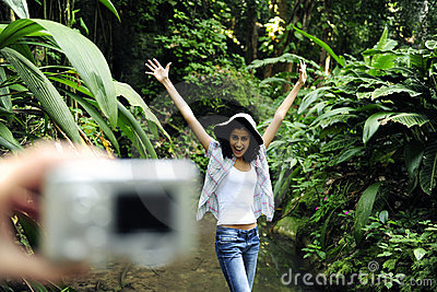 Tourist taking a photo with digital camera