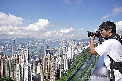 Tourist taking photo of Hong Kong