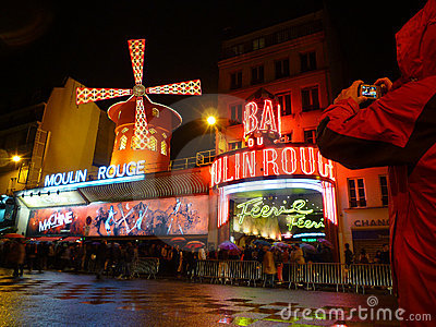 Tourist taking picture of Moulin Rouge Editorial Image