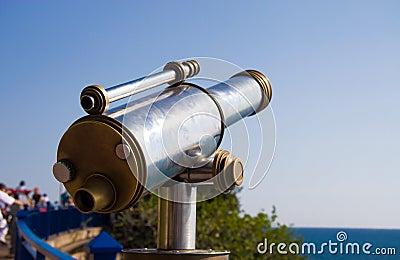 Tourist telescope at sea coast