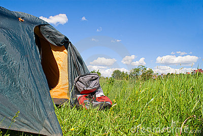Tourist tent and backpack