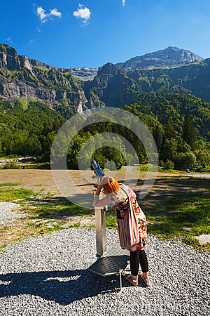 Tourist using coin operated telescope