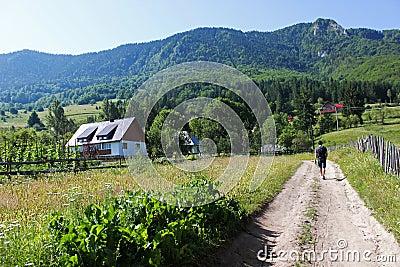 Tourist visiting mountain cottage