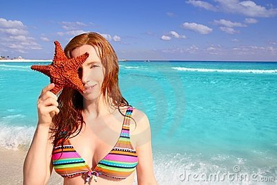 Tourist woman hold starfish tropical beach