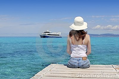 Tourist woman looking Formentera turquoise sea