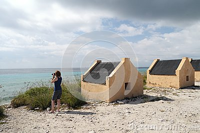 Tourist at Yellow Slave Huts - Bonaire