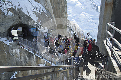 Tourists arrived by cable car at the central footbridge at the Aiguille du Midi Editorial Photo