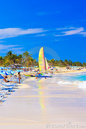 Tourists at the beach of Varadero in Cuba Editorial Stock Image