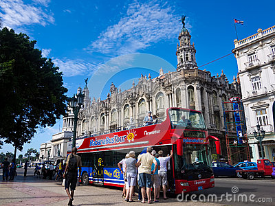 Tourists boarding a sightseeing bus in Havana Editorial Stock Photo