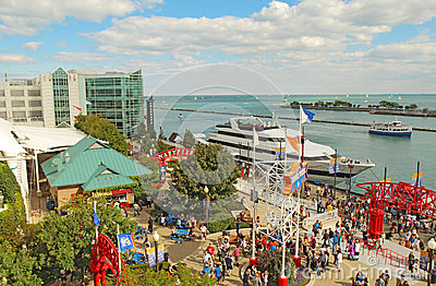 Tourists and boats at Navy Pier in Chicago, Illinois Editorial Stock Image