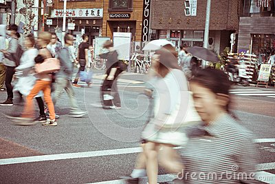 Tourists and business people crossing the street at Harajiku Editorial Photo