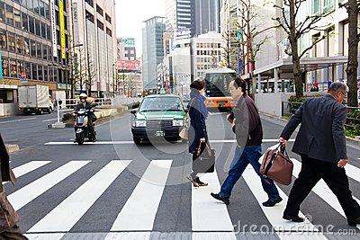 Tourists and business people crossing the street at Shinjuku Editorial Stock Photo